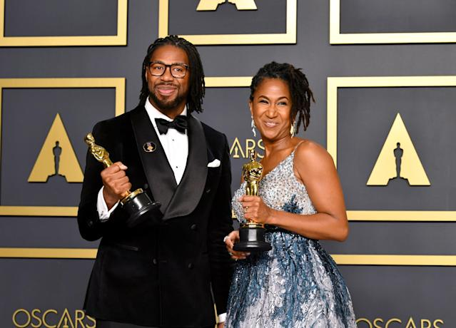 """Director Matthew A. Cherry and producer Karen Rupert Toliver, winners of the Animated Short Film award for """"Hair Love,"""" pose in the press room during the 92nd Annual Academy Awards at Hollywood and Highland on February 09, 2020 in Hollywood, California. (Photo by Amy Sussman/Getty Images)"""