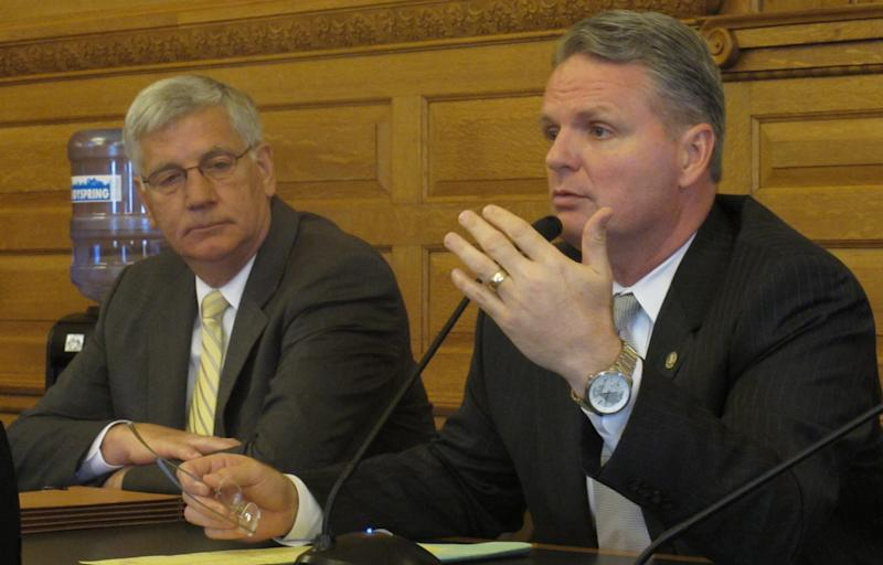 Kansas House Appropriations Committee Chairman Marc Rhoades, right, a Newton Republican, seeks more time to develop proposals in budget negotiations, Monday, May 9, 2011, at the Statehouse in Topeka, Kan. Rhoades is the House's lead negotiator in talks with the Senate, and watching him is Rep. Bill Feuerborn, of Garnett, the House Democrat involved in the discussions. (AP Photo/John Hanna)