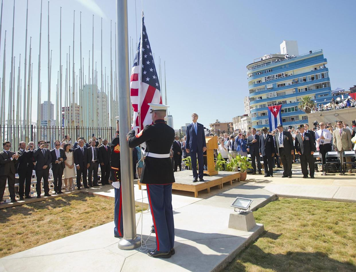 Secretary of State John Kerry and other dignitaries watch as U.S. Marines raise the U.S. flag over the newly reopened U.S. Embassy in Havana, Aug. 14, 2015. (Photo: Pablo Martinez Monsivais, Pool/AP)