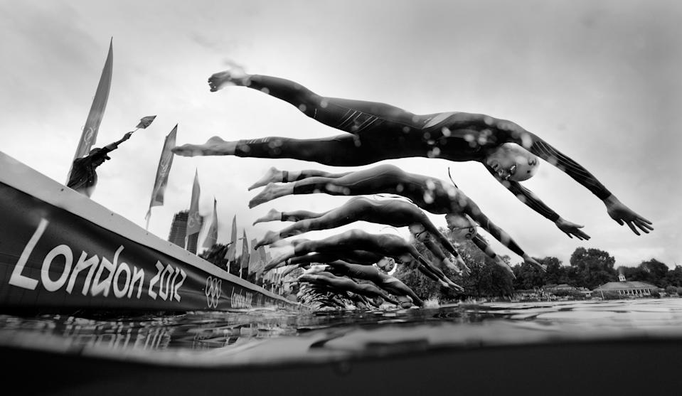 LONDON, ENGLAND - AUGUST 04: (EDITORS NOTE: Image has been converted to black and white.) Athletes begin the swimming leg of the Women's Triathlon on Day 8 of the London 2012 Olympic Games at Hyde Park on August 4, 2012 in London, England. (Photo by Adam Pretty/Getty Images)