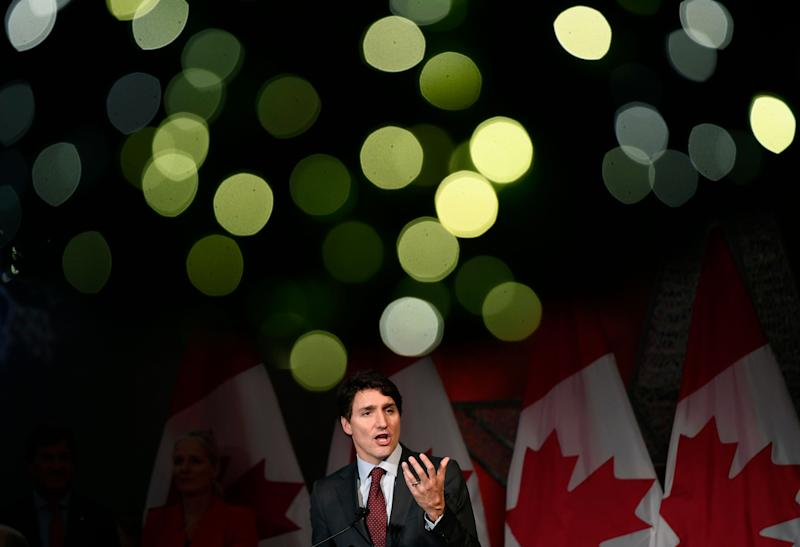 Christmas lights on a wreath glow above Prime Minister Justin Trudeau as he speaks to supporters at the Laurier Club holiday reception, an annual donor event held by the Liberal Party of Canada, in Ottawa on Dec. 9, 2019. (Photo: Justin Tang/CP)