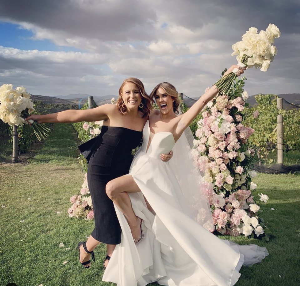 Georgia Love on her wedding day with her bridesmaid