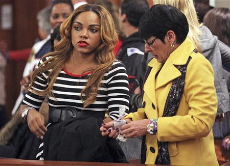 Terri Hernandez, mother of former New England Patriots tight end Aaron Hernandez and his fiancee Shayanna Jenkins watch in court during Hernandez' appearance at the Fall River Justice Center in Fall River, Massachusetts December 23, 2013. REUTERS/Matt Stone