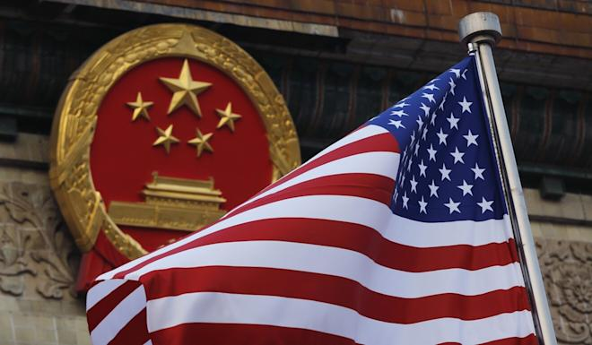 Banks and financial institutions could struggle to satisfy both sides in the US-China trade war. Photo: AP