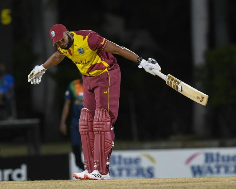 Six of the best: Kieron Pollard of the West Indies takes a bow after hitting six sixes off one over from Sri Lanka's Akila Dananjaya