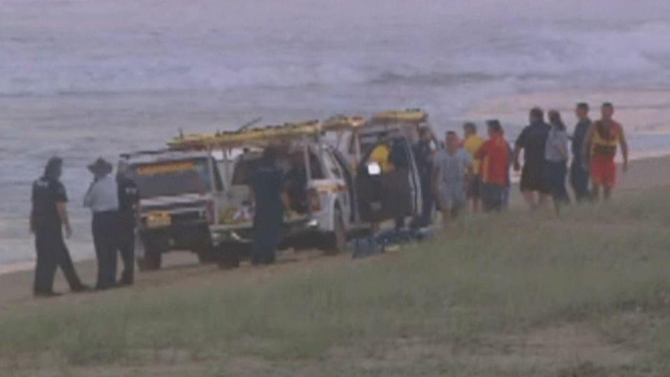 Paramedics tried to resuscitate a man who was pulled unconscious from rough surf on the Sunshine Coast.