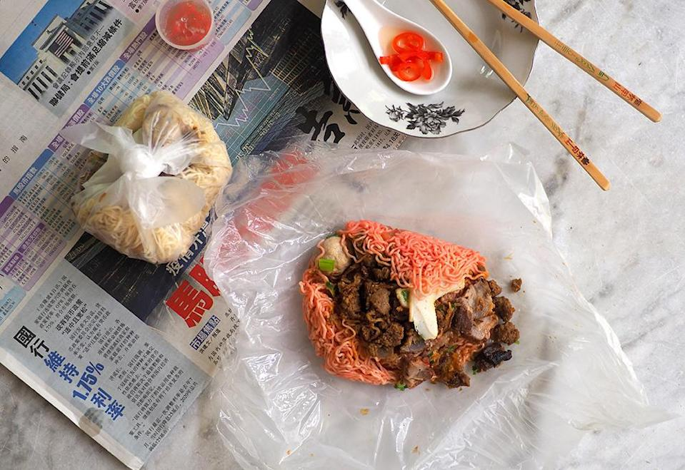 You can recreate that nostalgic coffee shop vibe at home with the 'kolo mee' wrapped in plastic and accompanied by pickled red chillies. — Pictures by Lee Khang Yi