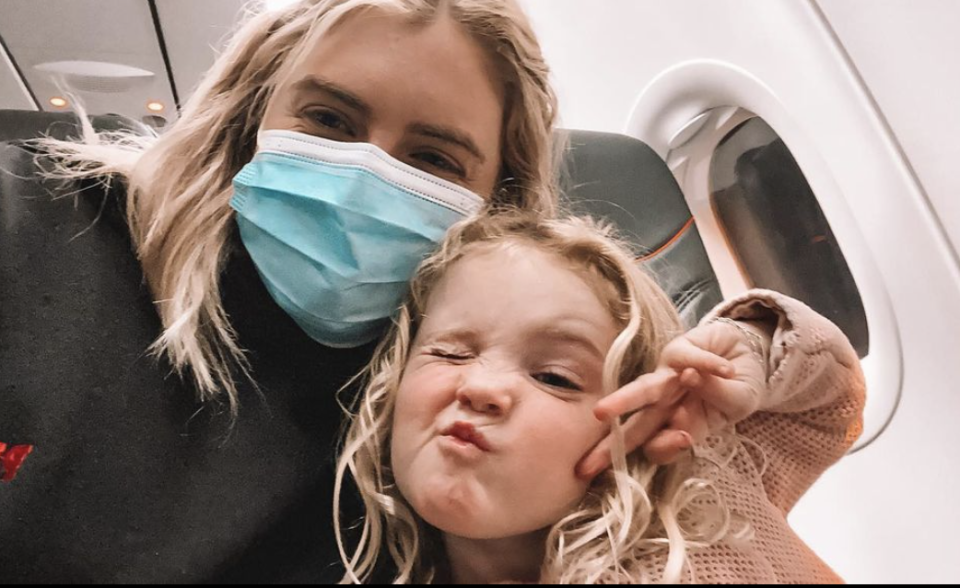 Megan Dalbeth and her daughter Hailey on an aeroplane.