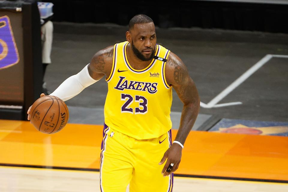 PHOENIX, ARIZONA - JUNE 01:  LeBron James #23 of the Los Angeles Lakers handles the ball in Game Five of the Western Conference first-round playoff series at Phoenix Suns Arena on June 01, 2021 in Phoenix, Arizona. NOTE TO USER: User expressly acknowledges and agrees that, by downloading and or using this photograph, User is consenting to the terms and conditions of the Getty Images License Agreement.  (Photo by Christian Petersen/Getty Images)