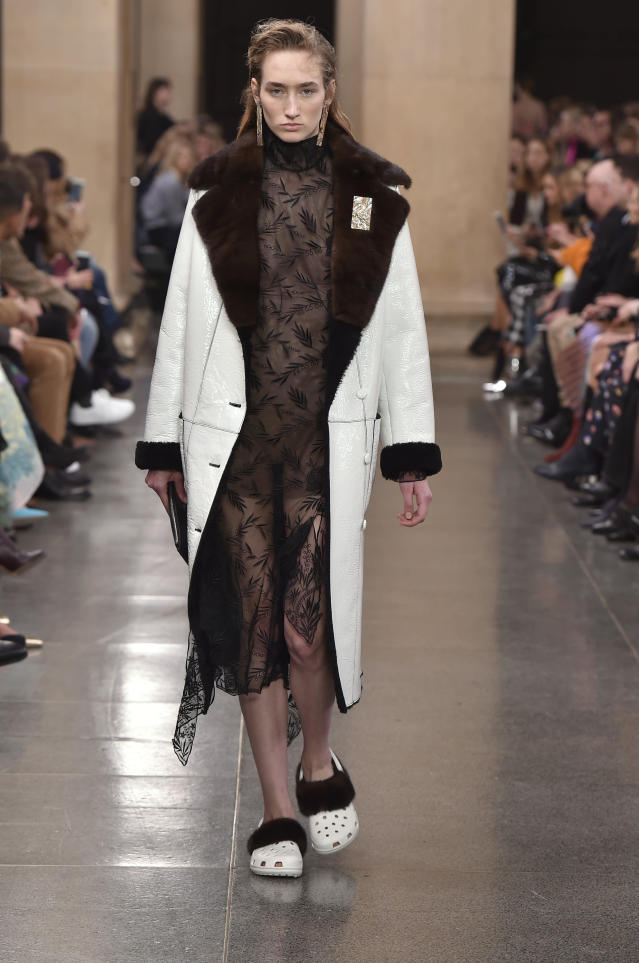 White, fur-covered crocs on at Christopher Kane on Feb. 20, 2017.