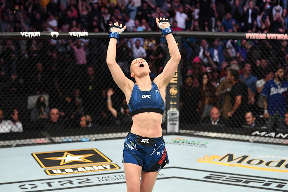 JACKSONVILLE, FLORIDA - APRIL 24: Rose Namajunas reacts after defeating Zhang Weili of China in their UFC women's strawweight championship bout during the UFC 261 event at VyStar Veterans Memorial Arena on April 24, 2021 in Jacksonville, Florida. (Photo by Josh Hedges/Zuffa LLC)