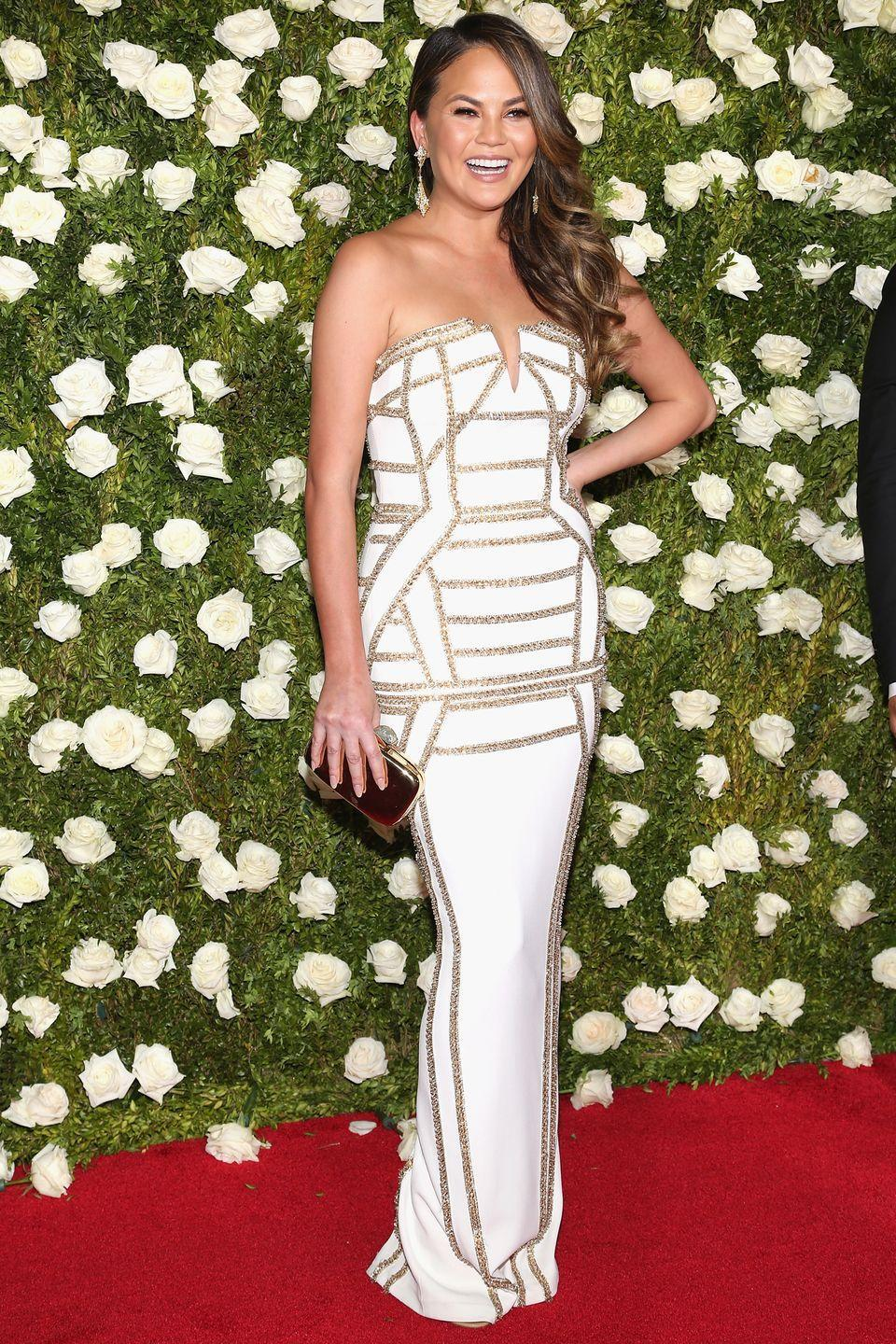 """<p>""""I had an armpit sucked out, which was one of the best things,"""" Teigen told <a href=""""http://www.refinery29.com/2017/05/153132/chrissy-teigen-liposuction-confession"""" rel=""""nofollow noopener"""" target=""""_blank"""" data-ylk=""""slk:Refinery29"""" class=""""link rapid-noclick-resp"""">Refinery29</a> in May 2017. """"It's a big secret, but I don't care. It was nine years ago or so. And I had two inches to my armpit. Now it's back though, so now I've gotta pay for [liposuction] again. It was so easy. It made me feel better in dresses, I felt more confident. It was the dumbest, stupidest thing I've ever done. The dumbest, but I like it, whatever. I have no regrets, honestly.""""</p><p>In 2019, Teigen also announced via an Instagram post that she would be <a href=""""https://www.harpersbazaar.com/celebrity/latest/a32683955/chrissy-teigen-coronavirus-test-responded-to-criticism-twitter/"""" rel=""""nofollow noopener"""" target=""""_blank"""" data-ylk=""""slk:removing her breast implants"""" class=""""link rapid-noclick-resp"""">removing her breast implants</a>. """"They've been great to me for many years but I'm just over it. I'd like to be able to zip a dress in my size, lay on my belly with pure comfort! No biggie!"""" she explained. """"So don't worry about me! All good. I'll still have boobs, they'll just be pure fat. Which is all a tit is in the first place. A dumb, miraculous bag of fat.""""</p>"""