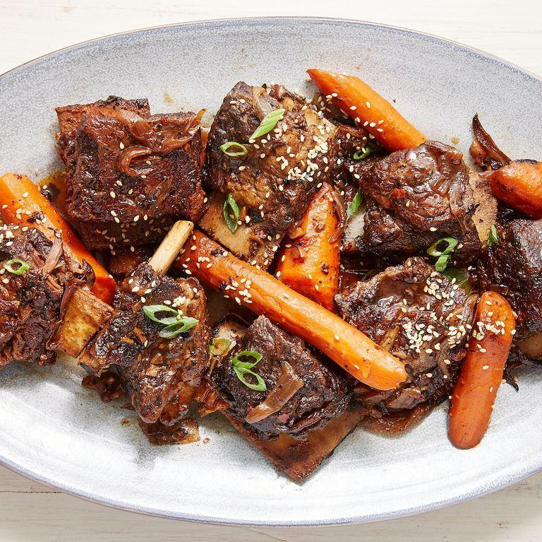 """<p>Looking for something outside the norm to serve for a special occasion? Few things feel as special—and as satisfying—as a well cooked beef <a href=""""https://www.delish.com/uk/cooking/recipes/a31389371/instant-pot-short-ribs-recipe/"""" rel=""""nofollow noopener"""" target=""""_blank"""" data-ylk=""""slk:short rib"""" class=""""link rapid-noclick-resp"""">short rib</a>. This version is fall-off-the-bone tender and insanely flavourful, thanks to a quick sear before slow cooking and a sauce that would make ANYTHING taste good. Skip the fancy meal out and make these stunners instead. </p><p>Get the <a href=""""https://www.delish.com/uk/cooking/recipes/a31465489/slow-cooker-short-ribs-recipe/"""" rel=""""nofollow noopener"""" target=""""_blank"""" data-ylk=""""slk:Slow Cooker Short Ribs"""" class=""""link rapid-noclick-resp"""">Slow Cooker Short Ribs</a> recipe.</p>"""