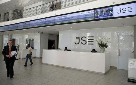 People walk near the reception at the Johannesburg Stock Exchange (JSE) in Sandton, Johannesburg, South Africa December 10, 2015. REUTERS/Siphiwe Sibeko/File Photo