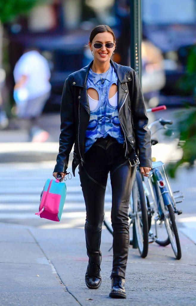 <p>Shayk wears chaps-style leather and denim jeans to do the school run with her daughter. </p>