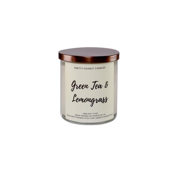 """<p><strong>Pretty Honest Shop</strong></p><p>prettyhonestshop.com</p><p><strong>$24.00</strong></p><p><a href=""""https://www.prettyhonestshop.com/collections/candles/products/green-tea-lemongrass-soy-candle"""" rel=""""nofollow noopener"""" target=""""_blank"""" data-ylk=""""slk:Shop Now"""" class=""""link rapid-noclick-resp"""">Shop Now</a></p><p>No harmful chemicals or additives here! This soy wax candle is a cleaner burn than paraffin—plus, it has a lead-free, cotton wick.</p>"""
