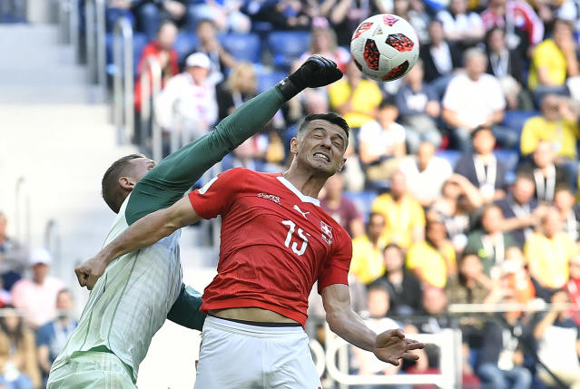 <p>Sweden goalkeeper Robin Olsen, left, defends against Switzerland's Blerim Dzemaili during the round of 16 match between Switzerland and Sweden at the 2018 soccer World Cup in the St. Petersburg Stadium, in St. Petersburg, Russia, Tuesday, July 3, 2018. (AP Photo/Martin Meissner) </p>
