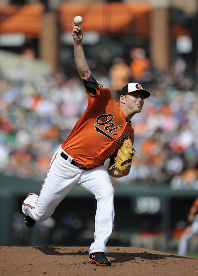 Baltimore Orioles starting pitcher Chris Tillman delivers a pitch against the New York Yankees during the first inning of a baseball game, Saturday, July 12, 2014, in Baltimore. (AP Photo/Nick Wass)