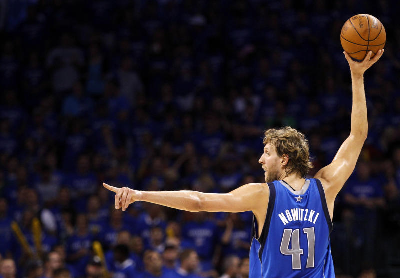 Dallas Mavericks forward Dirk Nowitzki (41) of Germany looks to pass the ball against the Oklahoma City Thunder in the first half of  Game 4 of the NBA Western Conference finals basketball series Monday, May 23, 2011, in Oklahoma City. (AP Photo/Eric Gay)