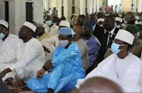 Goita, dressed in blue, at the prayers in Bamako's Grand Mosque shortly before the attack