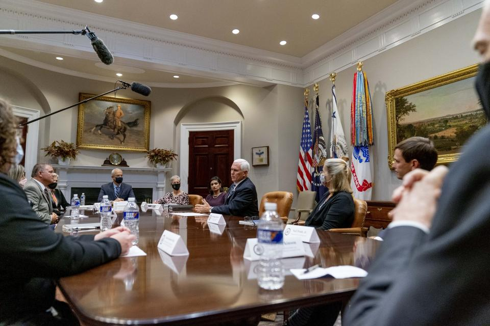 Vice President Mike Pence, center, accompanied by Administrator of the Centers for Medicare and Medicaid Services Seema Verma, center left, participates in a meeting on safety and quality for nursing homes in the Roosevelt Room of the White House, Thursday, Sept. 17, 2020, in Washington. (AP Photo/Andrew Harnik)