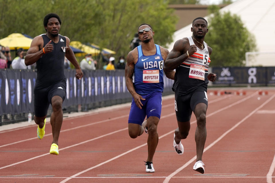 Trayvon Bromell, right, wins the 100-meter dash during the Sound Running Track Meet, Saturday, May 15, 2021, in Irvine, Calif. (AP Photo/Marcio Jose Sanchez)