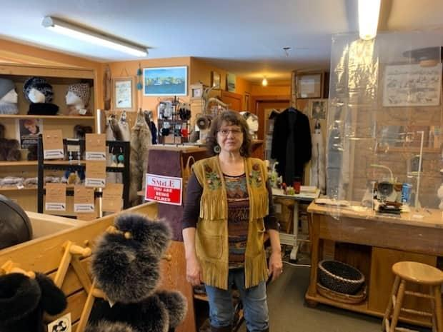 Kristine Bourque stands in her store Just Furs. She plans on closing the store and moving online by the end of April. (Alice Twa/CBC - image credit)