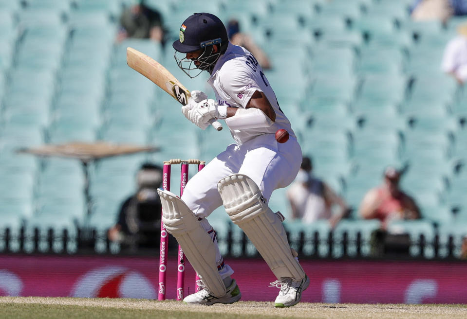 India's Cheteshwar Pujara reacts as he is hit while batting during play on the final day of the third cricket test between India and Australia at the Sydney Cricket Ground, Sydney, Australia, Monday, Jan. 11, 2021. (AP Photo/Rick Rycroft)