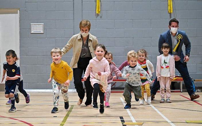 Run for the hills: Nicola Sturgeon campaigns with local candidate Fergus Mutch at the Benachie Leisure Centre - Getty