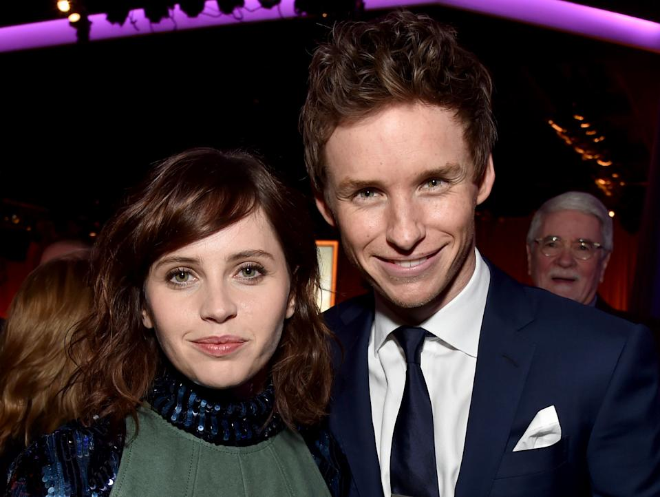 BEVERLY HILLS, CA - FEBRUARY 02:  Actors Felicity Jones (L) and Eddie Redmayne attend the 87th Annual Academy Awards Nominee Luncheon at The Beverly Hilton Hotel on February 2, 2015 in Beverly Hills, California.  (Photo by Kevin Winter/Getty Images)