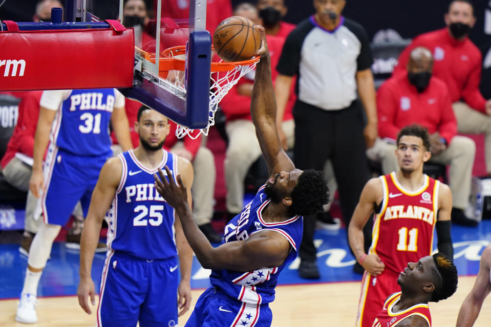 Philadelphia 76ers' Joel Embiid dunks the ball during the first half of Game 2 in a second-round NBA basketball playoff series against the Atlanta Hawks, Tuesday, June 8, 2021, in Philadelphia. (AP Photo/Matt Slocum)