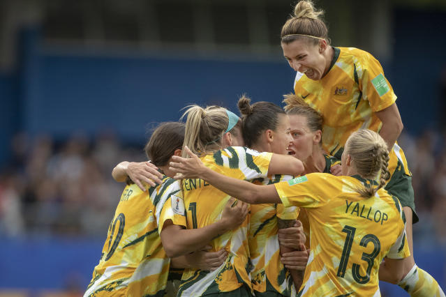 MONTPELLIER, FRANCE June 13. Australia celebrate their second goal scored by Sam Kerr #20 of Australia as Steph Catley #7 of Australia jumps on her team mates during the Australia V Brazil, Group C match at the FIFA Women's World Cup at Stade La Mosson Stadium on June 13th 2019 in Montpellier, France. (Photo by Tim Clayton/Corbis via Getty Images)