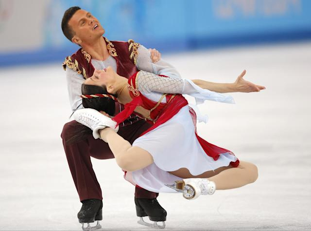 Charlene Guignard and Marco Fabbri of Italy compete in the ice dance free dance figure skating finals at the Iceberg Skating Palace during the 2014 Winter Olympics, Monday, Feb. 17, 2014, in Sochi, Russia. (AP Photo/Vadim Ghirda)