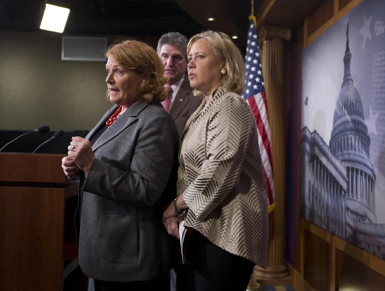 Sen. Mary Landrieu, D-La., chair of the Senate Energy and Natural Resources Committee, and the Keystone XL oil pipeline bill sponsor, right, Sen. Joe Manchin, D-W. Va., center, and Sen. Heidi Heitkamp, D-N.D., left, participate in a news conference on Capitol Hill in Washington, Tuesday, Nov. 18, 2014. The U.S. Senate has rejected a proposal to fast-track the approval of the controversial Keystone XL pipeline. (AP Photo/Carolyn Kaster)