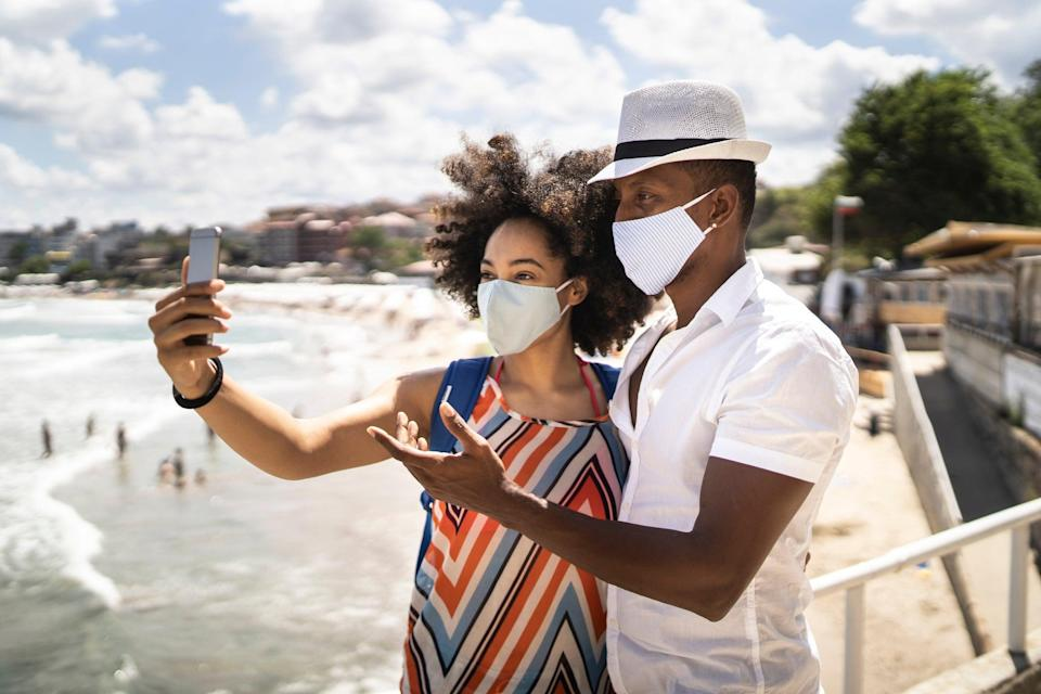 Will your summer holiday destination require you to wear a face mask? (Getty Images)