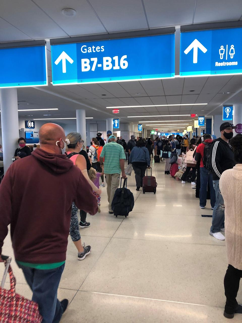 Travelers wear face masks at a busy American Airlines concourse at Charlotte-Douglas International Airport in November.