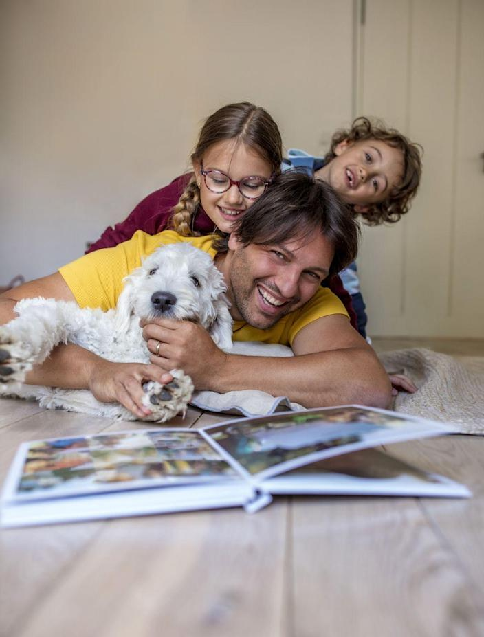 """<p>Ask Dad to get out his old photo albums from back in the day. The kids will be tickled at the idea that there was a time when photos weren't <em>all</em> on cell phones! Flipping through the albums together is sure to inspire memories and hilarious childhood stories. </p><p><a class=""""link rapid-noclick-resp"""" href=""""https://go.redirectingat.com?id=74968X1596630&url=https%3A%2F%2Fwww.walmart.com%2Fip%2FPinnacle-My-Sunshine-Photo-Album-Holds-120-4-x6-Photos%2F51434801&sref=https%3A%2F%2Fwww.thepioneerwoman.com%2Fholidays-celebrations%2Fg36333267%2Ffathers-day-activities%2F"""" rel=""""nofollow noopener"""" target=""""_blank"""" data-ylk=""""slk:SHOP PHOTO ALBUMS"""">SHOP PHOTO ALBUMS</a></p>"""