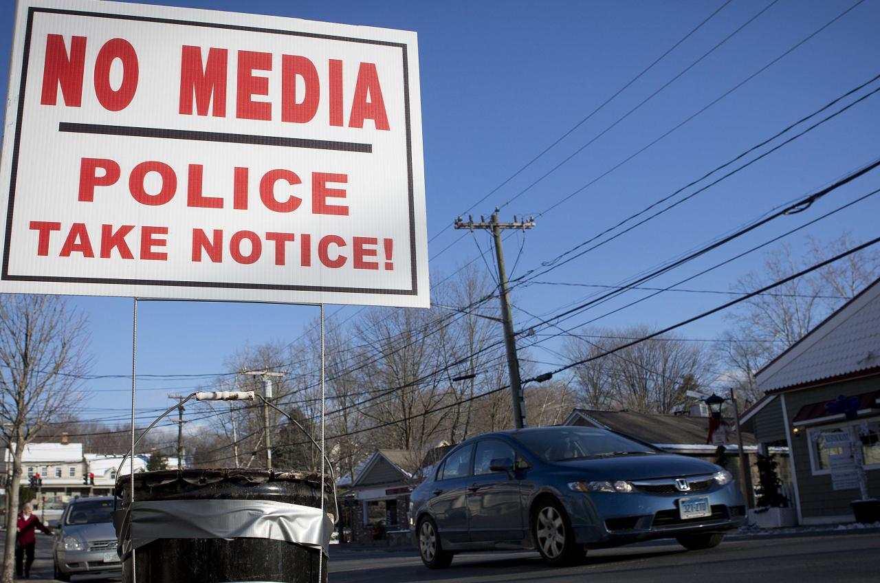 A sign is pictured in the Sandy Hook area of Newtown, Connecticut December 13, 2013. December 14th marks the one year anniversary of the shooting rampage at Sandy Hook Elementary School, where 20 children and six adults were killed by gunman Adam Lanza. REUTERS/Carlo Allegri (UNITED STATES - Tags: CIVIL UNREST)