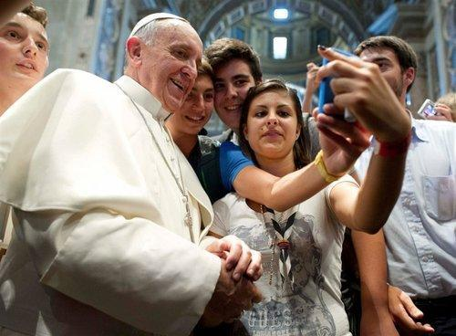 Teens taking a selfie with the pope