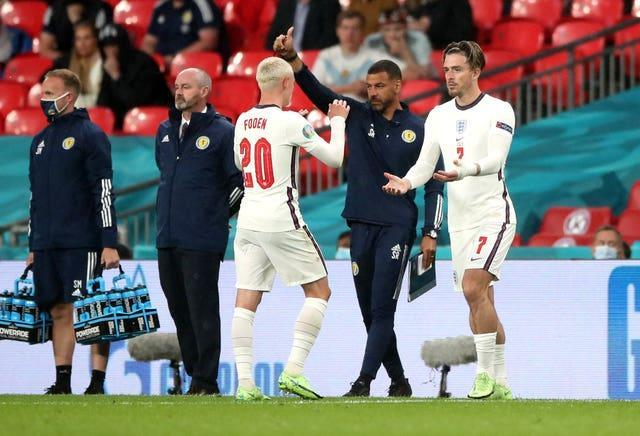 Jack Grealish, right, replaces Phil Foden