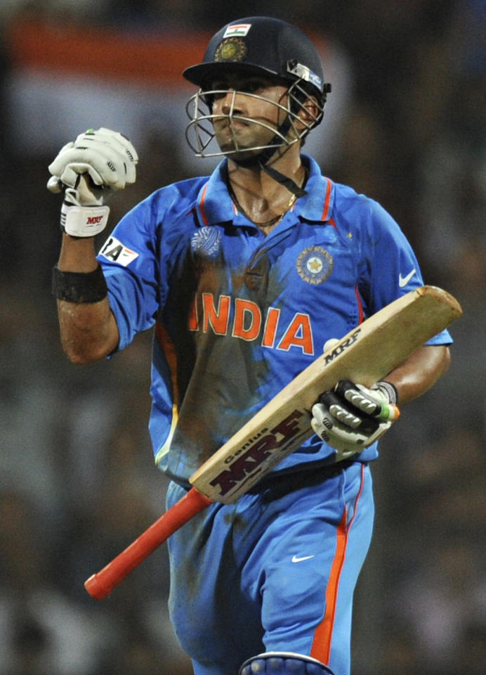 Indian batsman Gautam Gambhir pumps his fist after completing 50 runs during the ICC Cricket World Cup final between India and Sri Lanka at Wankhede Stadium in Mumbai on April 2, 2011. AFP PHOTO/Indranil MUKHERJEE (Photo credit should read INDRANIL MUKHERJEE/AFP/Getty Images)