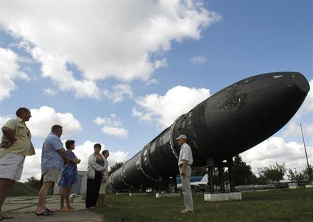 Visitors look at a SS-18 SATAN intercontinental ballistic missile at the Strategic Missile Forces museum near Pervomaysk, some 300 km (186 miles) south of Kiev, August 22, 2011. REUTERS/Gleb Garanich