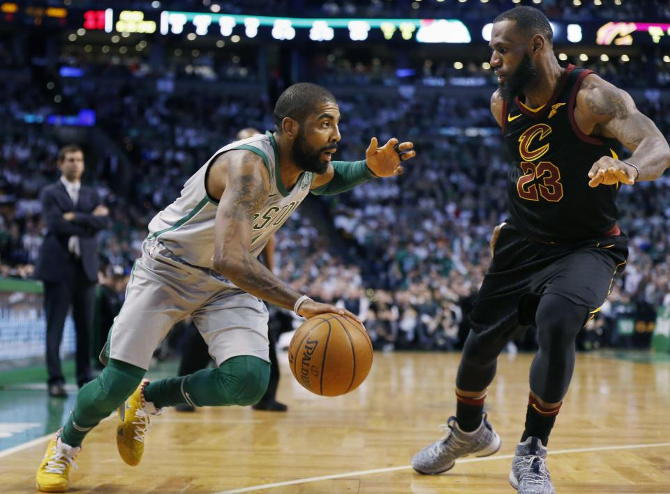 Boston Celtics' Kyrie Irving drives past Cleveland Cavaliers' LeBron James (23) during the first quarter of an NBA basketball game in Boston, Sunday, Feb. 11, 2018. (AP Photo/Michael Dwyer)