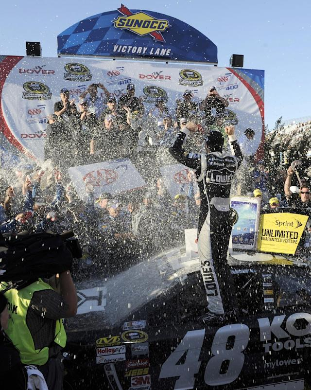 Jimmie Johnson celebrates in Victory Lane after he won the NASCAR Sprint Cup series auto race, Sunday, Sept. 29, 2013, at Dover International Speedway in Dover, Del. (AP Photo/Nick Wass)