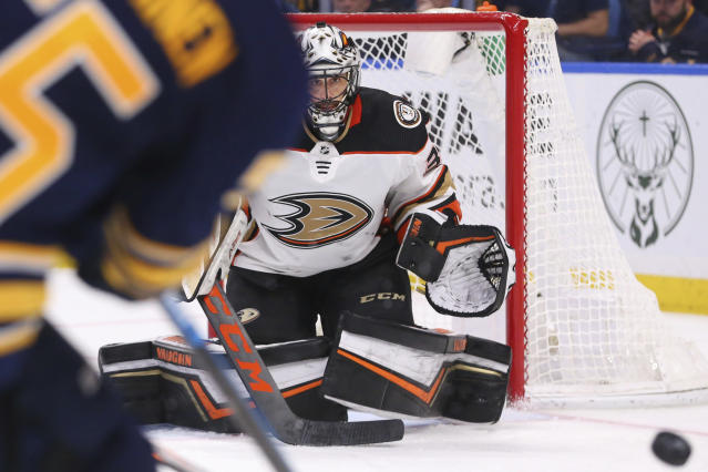 Anaheim Ducks goalie Ryan Miller (30) keeps his eyes on the puck during the third period of an NHL hockey game against the Buffalo Sabres, Sunday, Feb. 9, 2020, in Buffalo, N.Y. (AP Photo/Jeffrey T. Barnes)