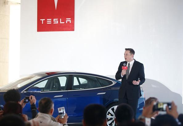 "Elon Musk, CEO of Tesla complained on Twitter about China's tariff on imported vehicles, which put him ""competing in an Olympic race wearing lead shoes."" (Getty Images)"