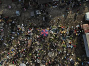 People gather on the first market day since the earthquake in Camp Perrin, Haiti, Friday, Aug. 20, 2021, six days after a 7.2 magnitude quake hit. (AP Photo/Fernando Llano)