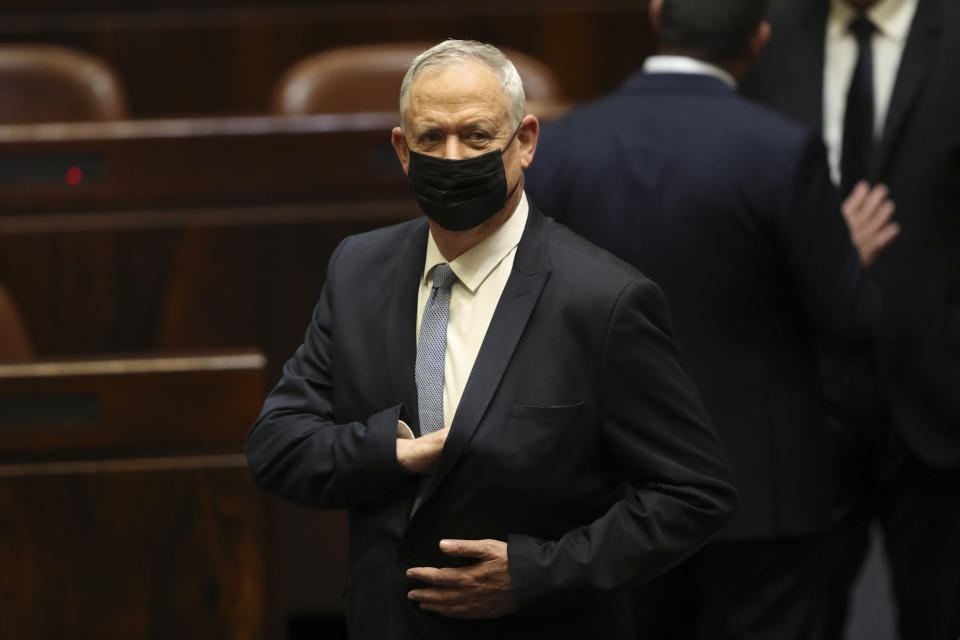 Israeli politician Benny Gantz stands during a Knesset session in Jerusalem Sunday, June 13, 2021. Bennett is expected later Sunday to be sworn in as the country's new prime minister, ending Prime Minister Benjamin Netanyahu's 12-year rule. (AP Photo/Ariel Schali22