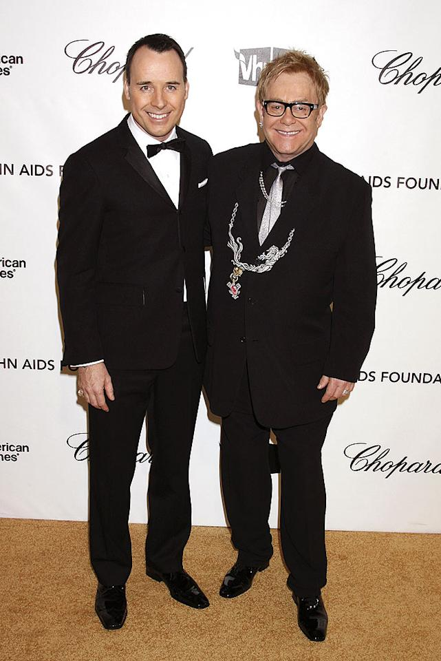 """Sir Elton John (pictured here with partner David Furnish) has been out for twenty years. His tireless support of AIDS charities has garnered him as much respect as his singing/songwritng talent. Jeffrey Mayer/<a href=""""http://www.wireimage.com"""" target=""""new"""">WireImage.com</a> - February 24, 2008"""