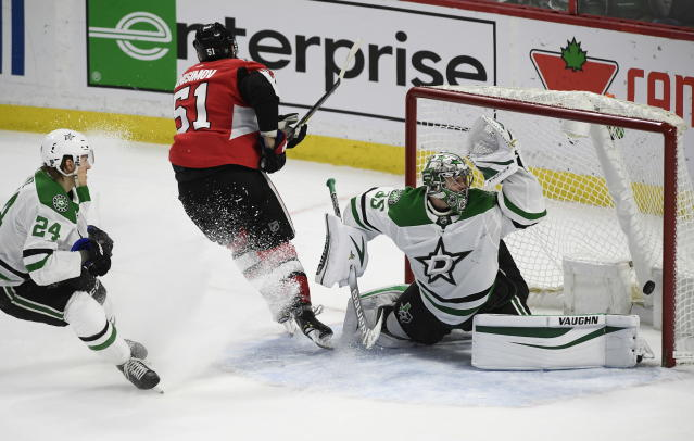 Ottawa Senators center Artem Anisimov (51) scores on Dallas Stars goaltender Anton Khudobin (35) in overtime of an NHL hockey game Sunday, Feb. 16, 2020, in Ottawa, Ontario. (Justin Tang/The Canadian Press via AP)